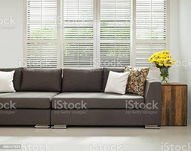 Photo of Grey sofa in simple setting