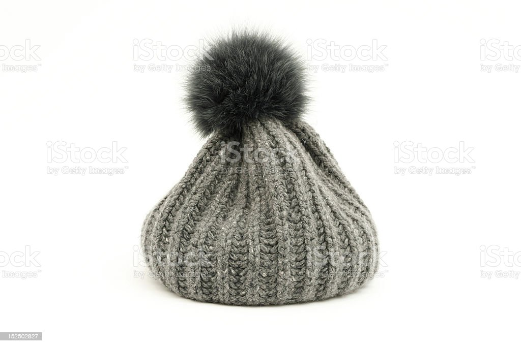 Grey soft cap with bob over white background stock photo