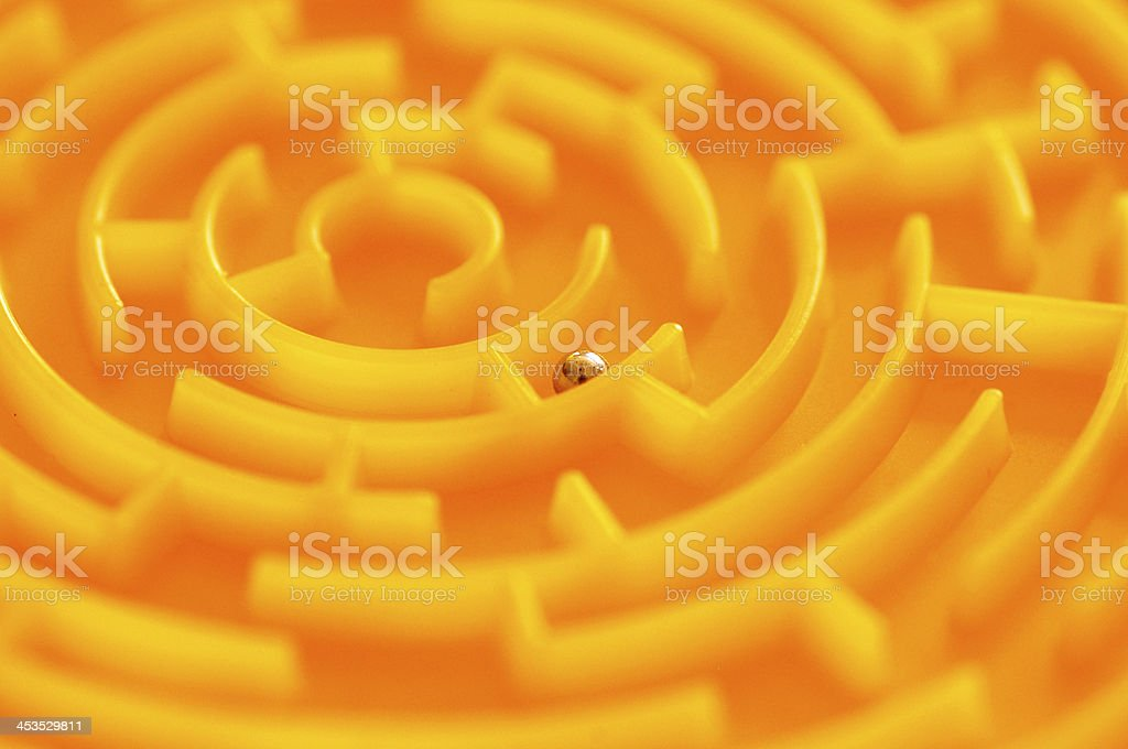 Grey sphere in golden labyrinth royalty-free stock photo