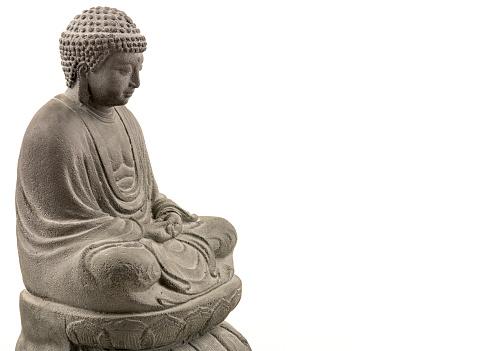 Grey stone buddha on white background