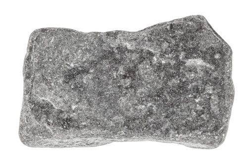 Grey stone isolated on white. Focus is front to back.