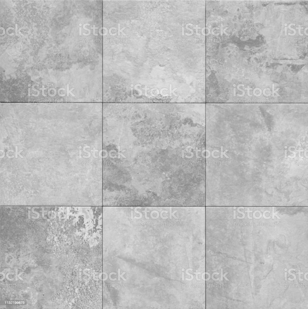 grey stone texture pattern - patchwork tile  /  tiled background stock photo