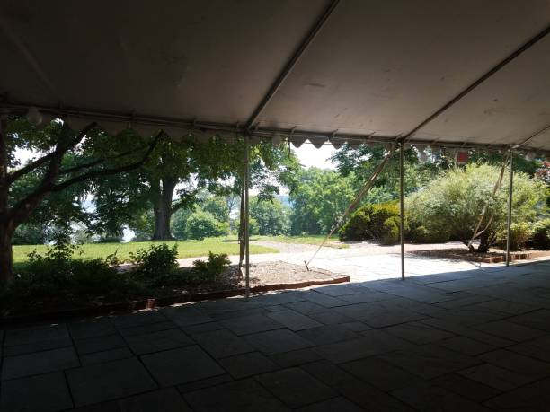 grey stone tiles and tent and trees stock photo
