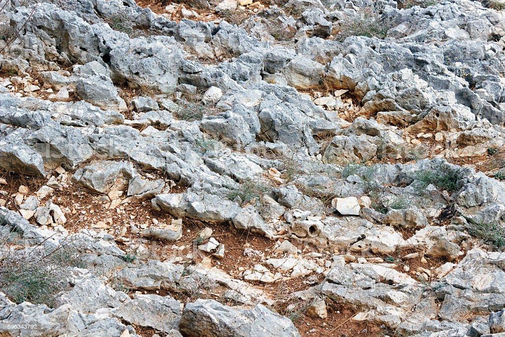 Grey stones on a red ground. Lizenzfreies stock-foto