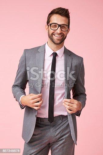 620404536istockphoto Grey suit happy guy 857348878