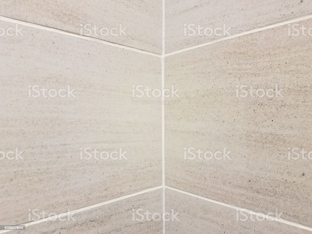 grey tiles in a corner of a bathroom stock photo