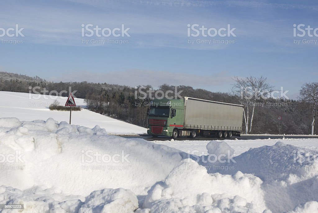 Grey truck on the road in a snow-covered landscape royalty-free stock photo