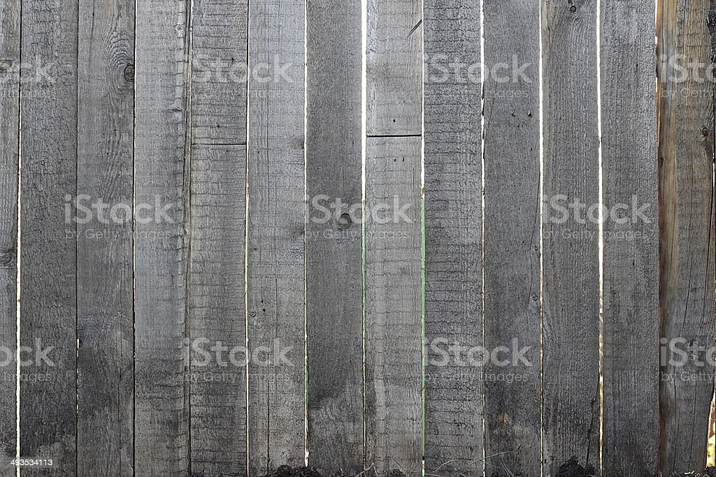 Grey wooden fence, close-up stock photo