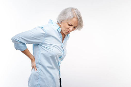 istock Grey-haired woman suffering from pain in lower back 854411538