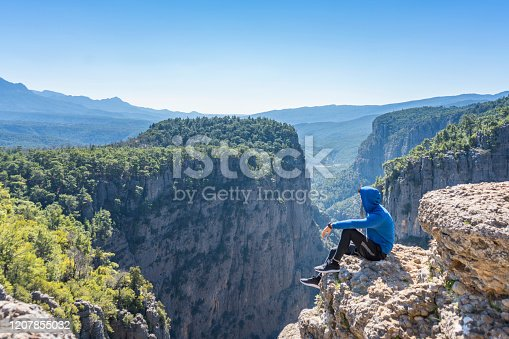 Greyhound Canyon. An athlete sitting against the landscape