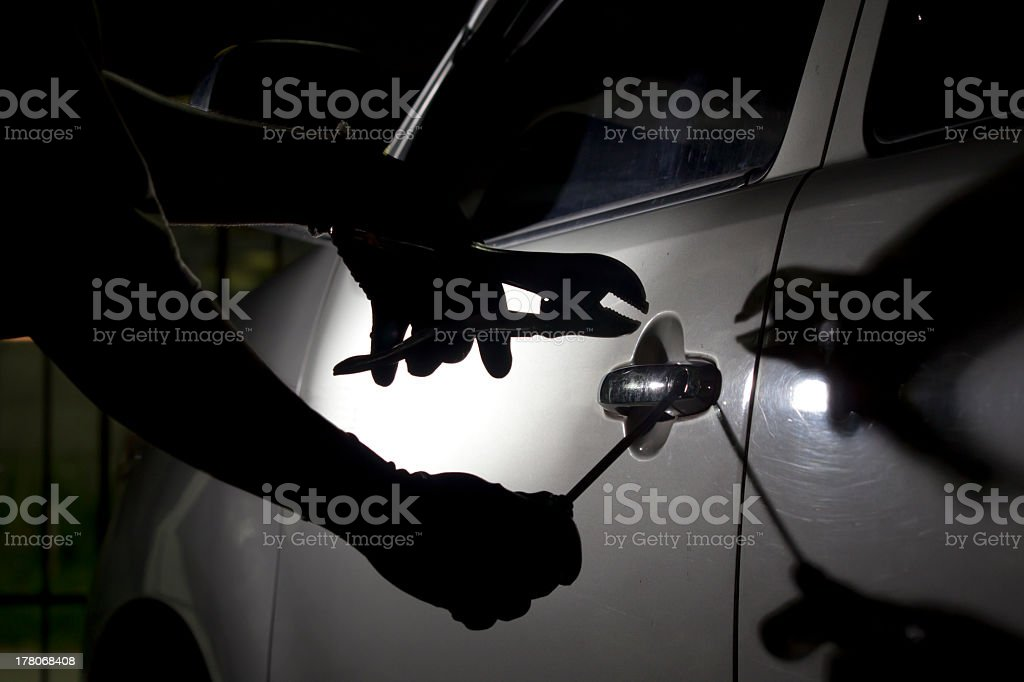 Greyscale illustration of a car this breaking in with tools stock photo
