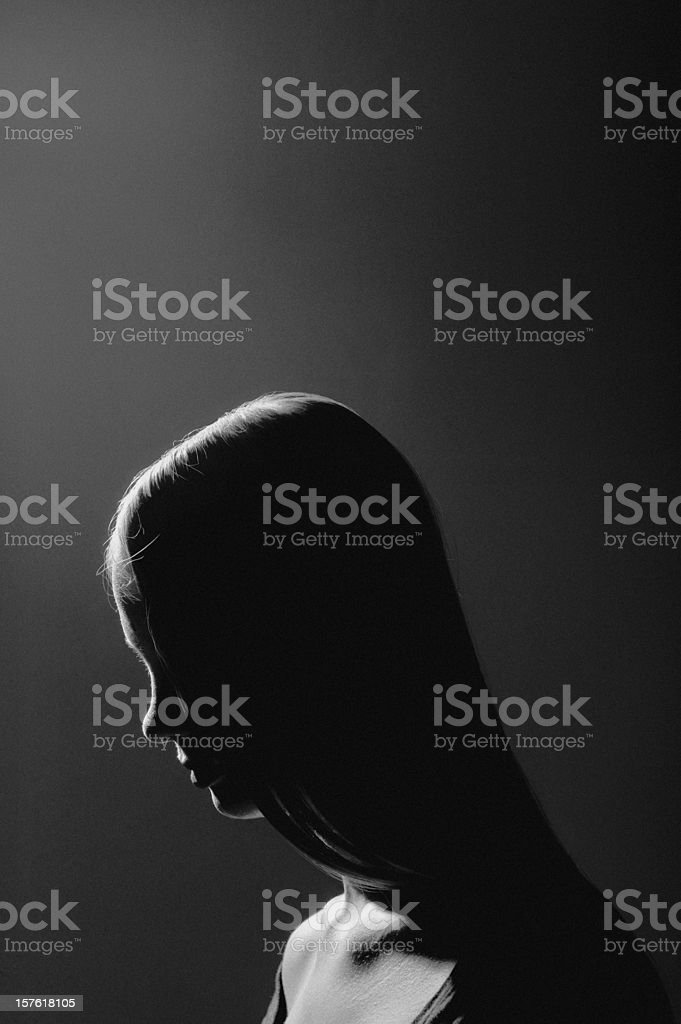 Greyscale photo of a long haired woman stock photo