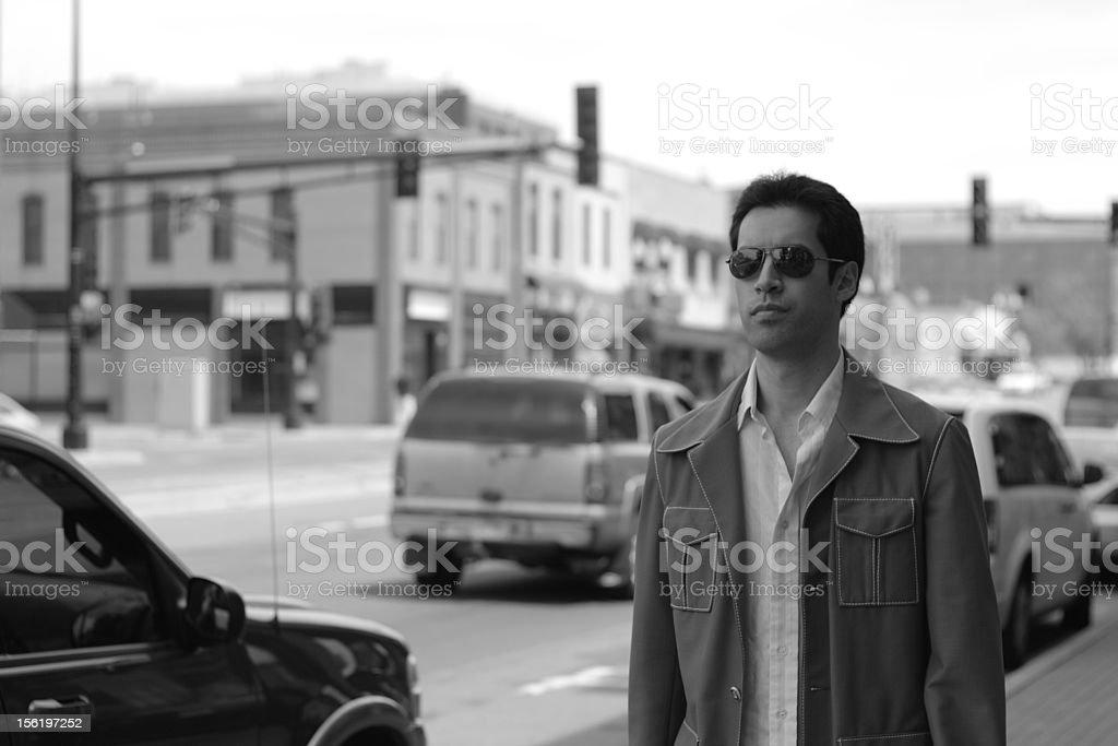 greyscale suit on sidewalk stock photo
