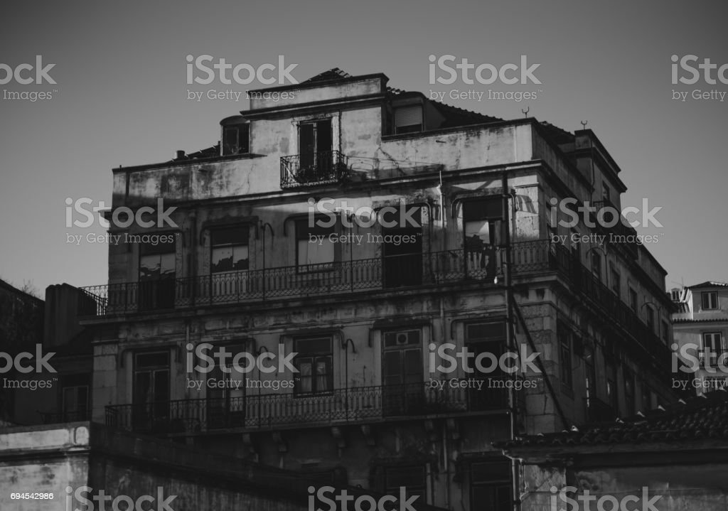 Greyscale view of abandoned house in Lisbon, Portugal stock photo