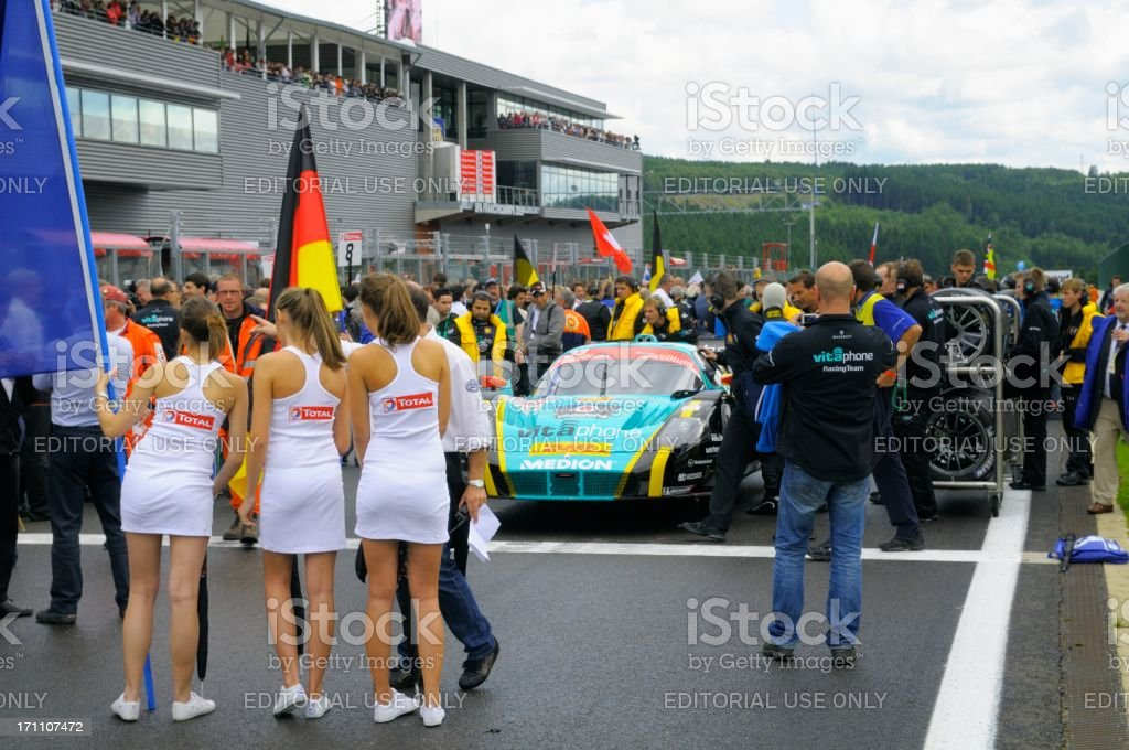Grid girls at the start grid before the race stock photo