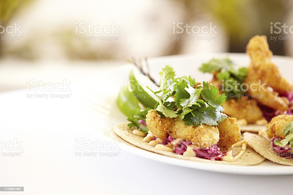 Griddled mahi fish tacos, cilantro and lime on corn tortillas stock photo