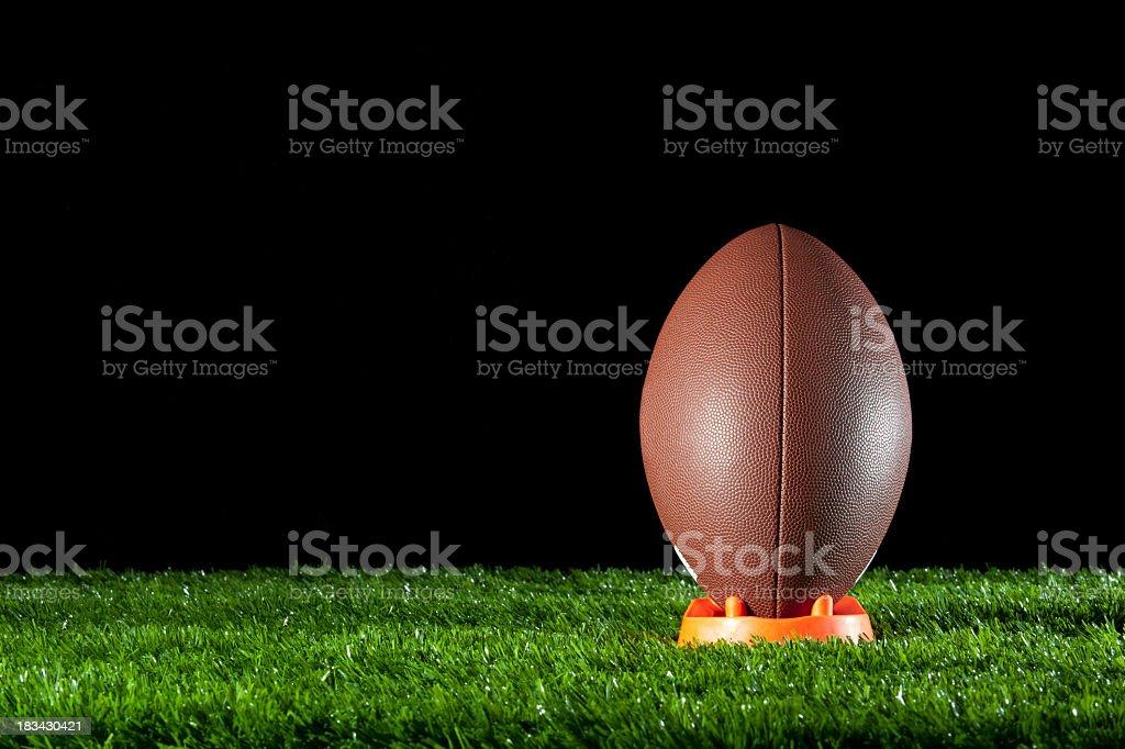 Gridiron ball standing on a tee stock photo