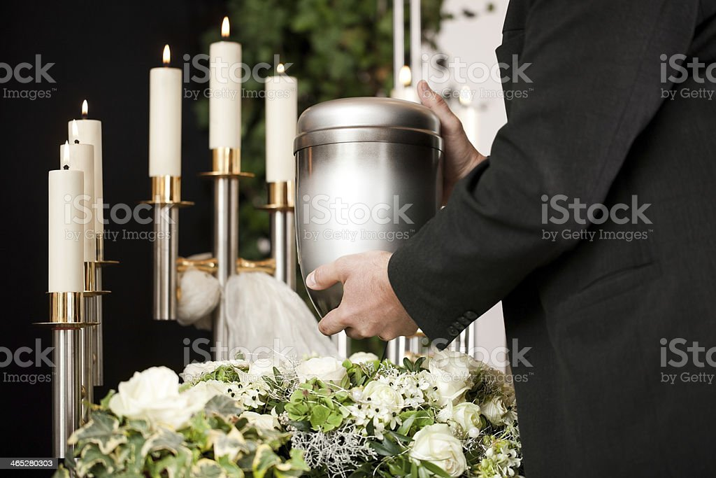 Grief - urn Funeral and cemetery stock photo