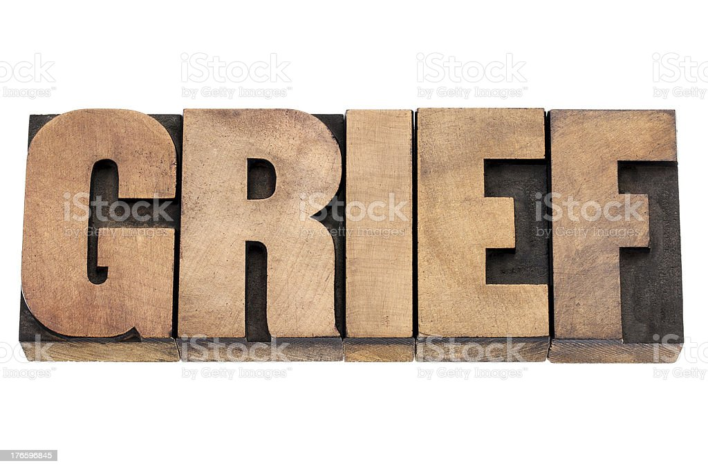 grief word in wood type stock photo