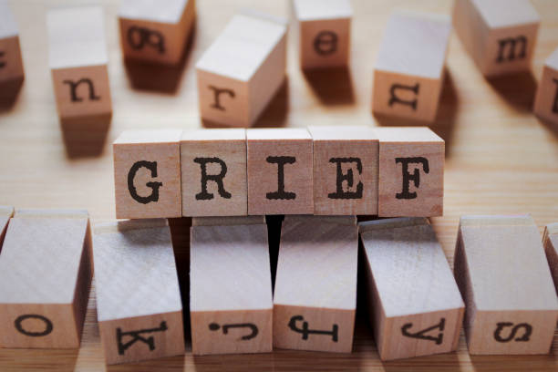 Grief Word In Wooden Stamp Cube stock photo