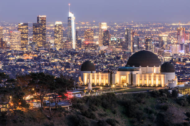 Griffith Observatory Park with Los Angeles Skyline at Dusk. Twilight views of the famous monument and downtown from Santa Monica Eastern Mountains. Los Angeles, California, USA. hollywood california stock pictures, royalty-free photos & images