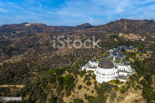istock Griffith Park Observatory with Hollywood Sign in upper left corner. 1298195952