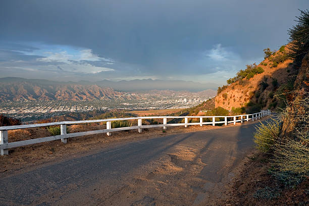 griffith park road above burbank and glendale california - san fernando valley stock photos and pictures