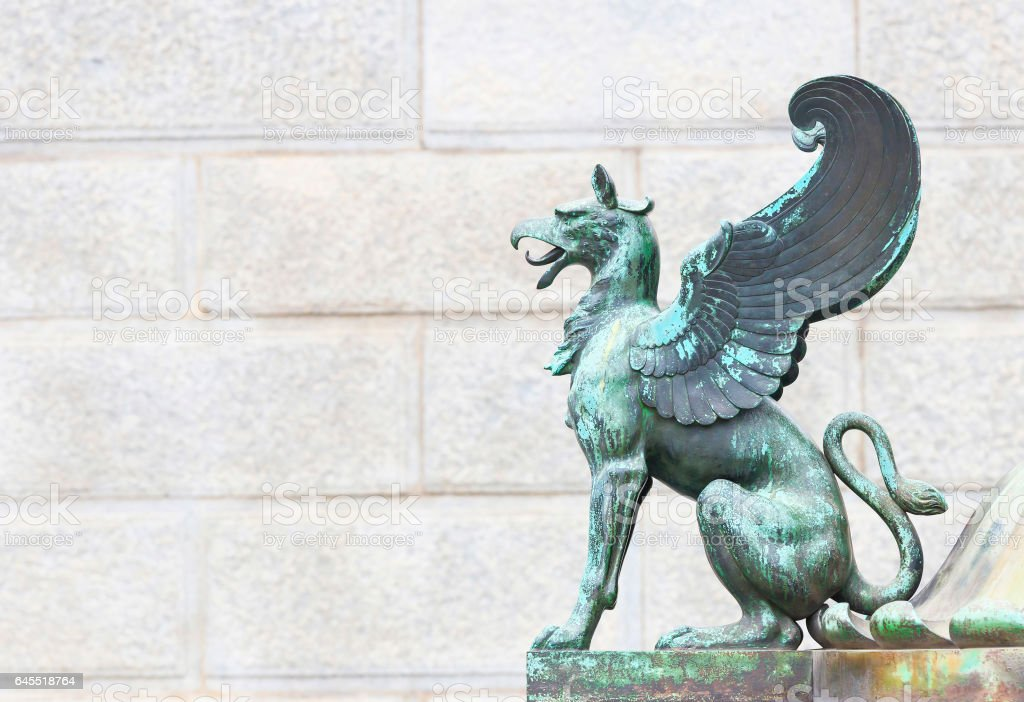 Griffon sculpture in front of Austrian parlaiment building stock photo