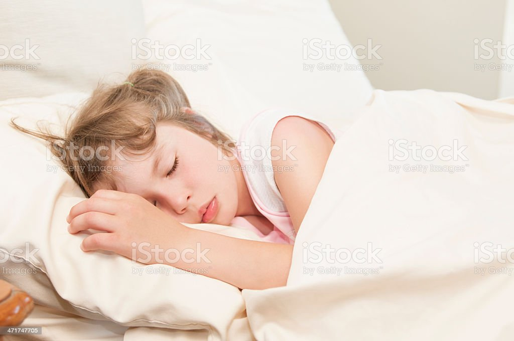 Gril Child Sleeping oh a White Bed royalty-free stock photo