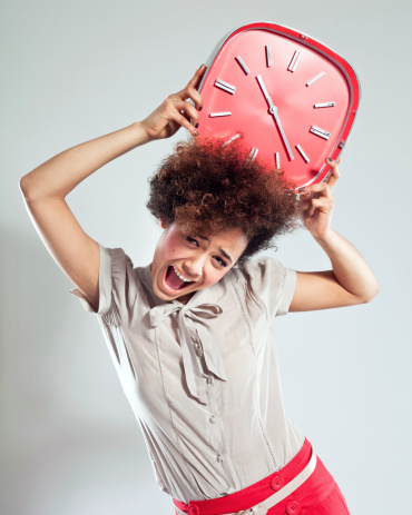 Gril With Red Clock Stock Photo - Download Image Now