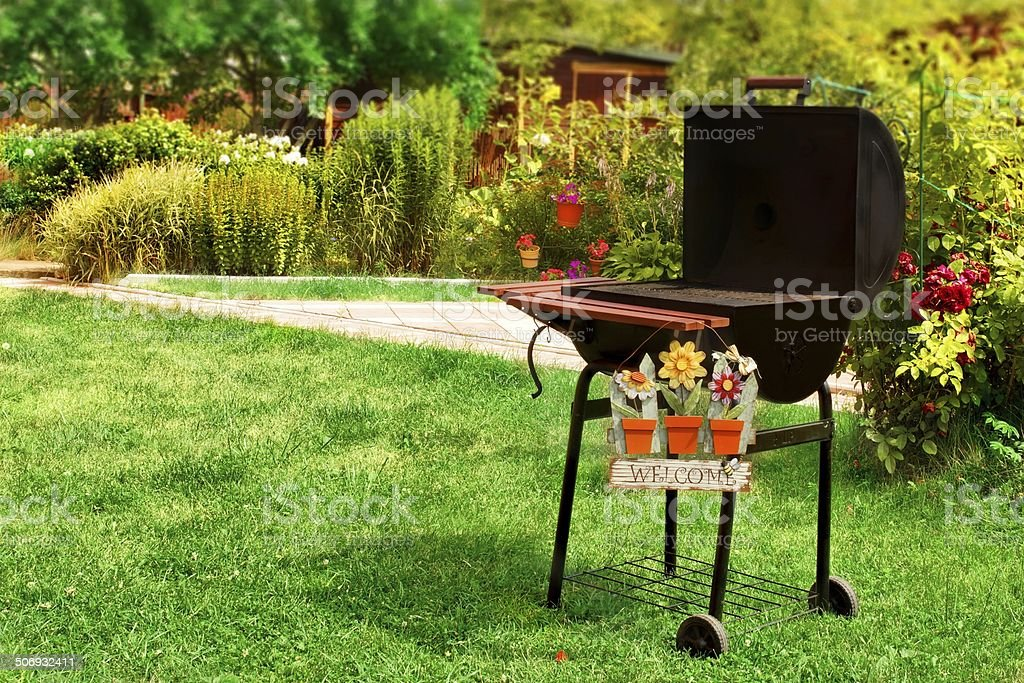 BBQ Grill and WELCOME sign in the Backyard stock photo