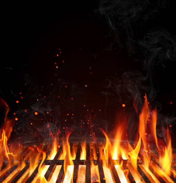 grill barbecue background - empty grate with flames on black - barbecue grill stock photos and pictures