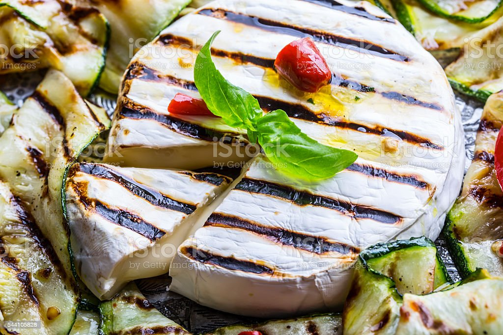 Grill Brie camembert cheese zucchini with chili pepper. stock photo