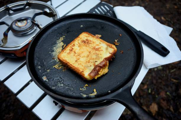 Grill cheese sandwich on camp stove griddle stock photo