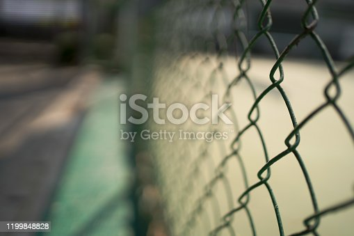 Grill fence at outdoor sport court