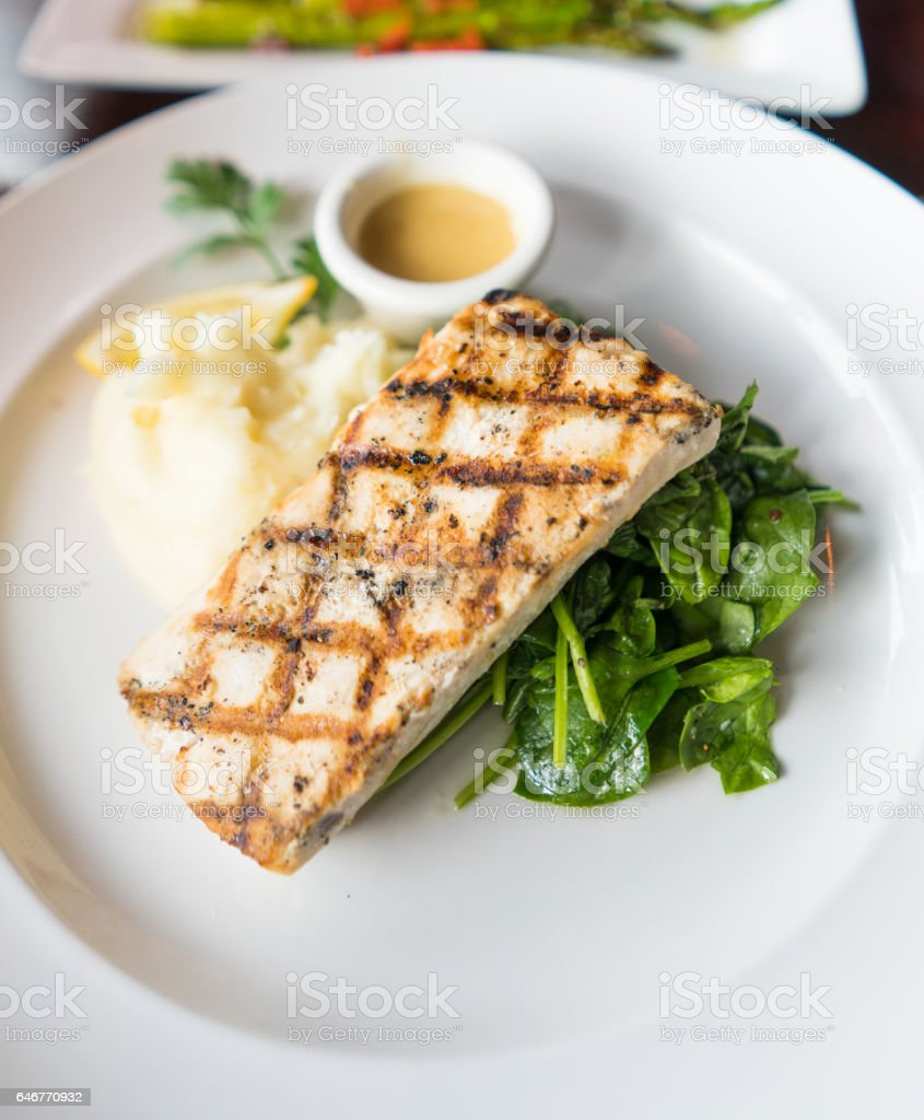 Grill fish and spinach stock photo