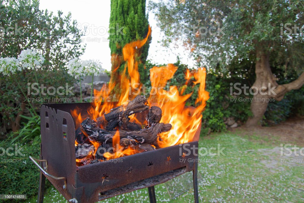 Grill for barbecue with flame in open space of backyard stock photo