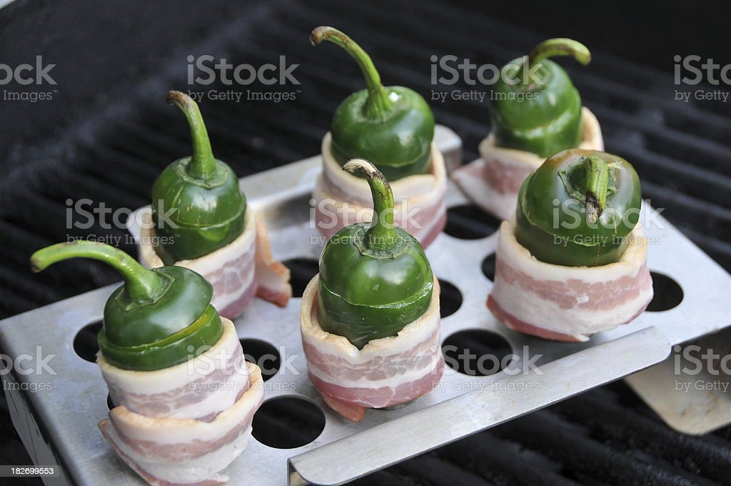 Grill: Jalapeno Peppers Wrapped in Bacon stock photo
