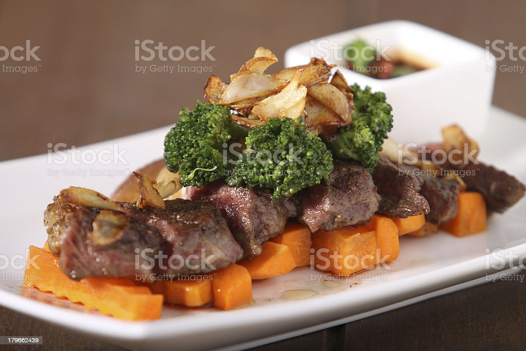 Grill marinated Pork with Spicy Sauce, Broccolis  and Carrots royalty-free stock photo