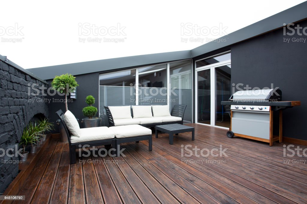 Grill on terrace with plants stock photo
