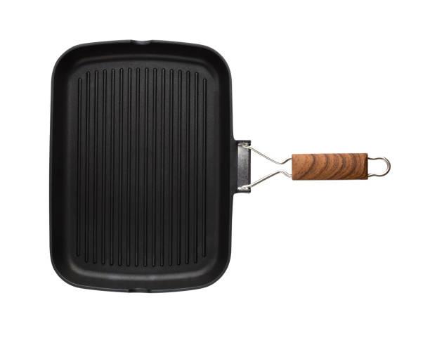 grillpanna isolerad på vit bakgrund. ny grill pan närbild på en vit bakgrund. - frying pan bildbanksfoton och bilder