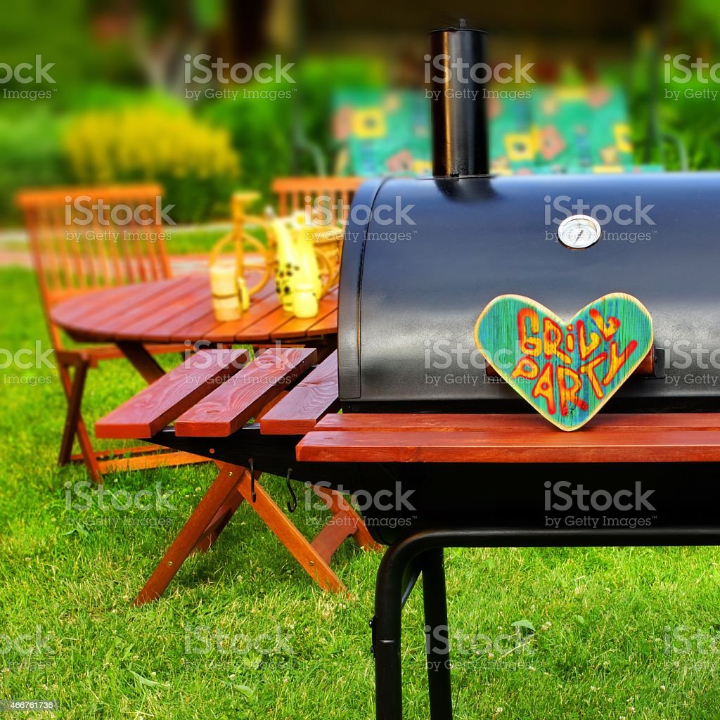 Grill Party Sign on Wood Heart stock photo