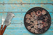 Grill with glowing charcoal briquettes