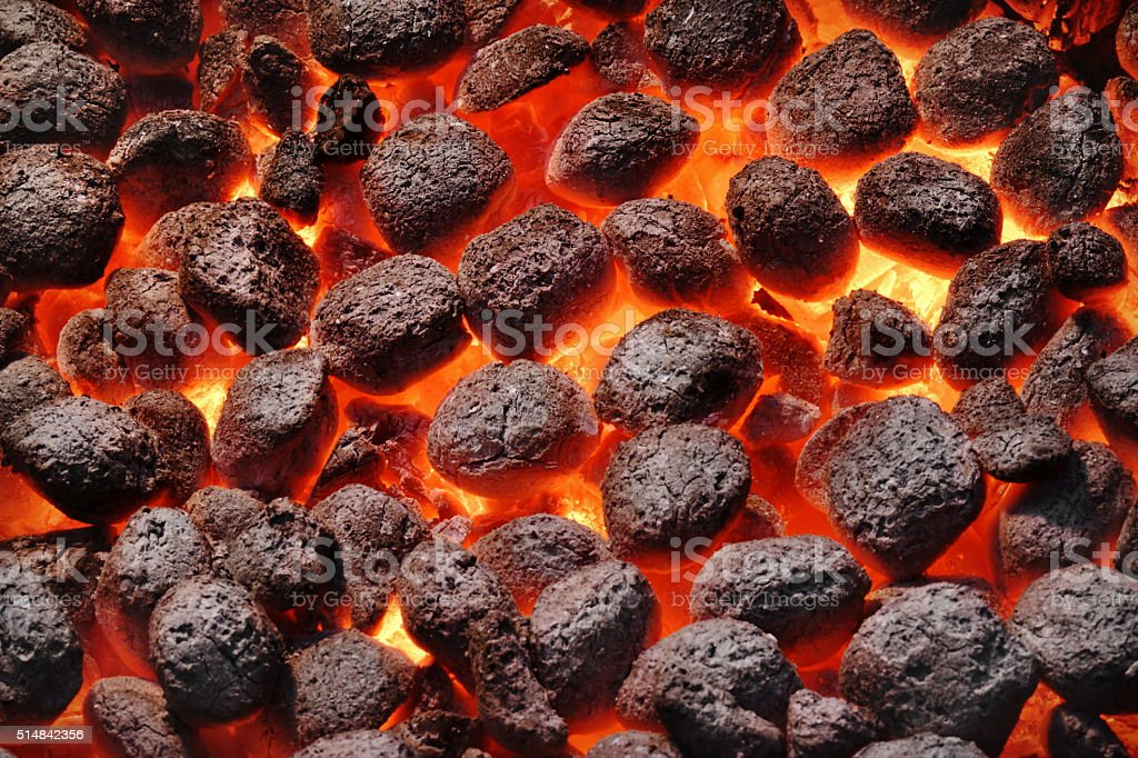 BBQ Grill Pit With Glowing Hot Charcoal Briquettes, Closeup stock photo