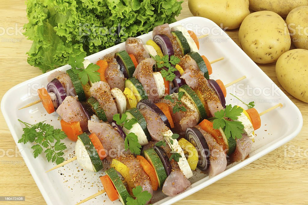 Grill skewer preparation royalty-free stock photo