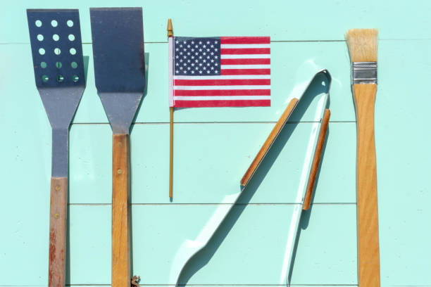 grill tools and small american flag - memorial day weekend stock pictures, royalty-free photos & images