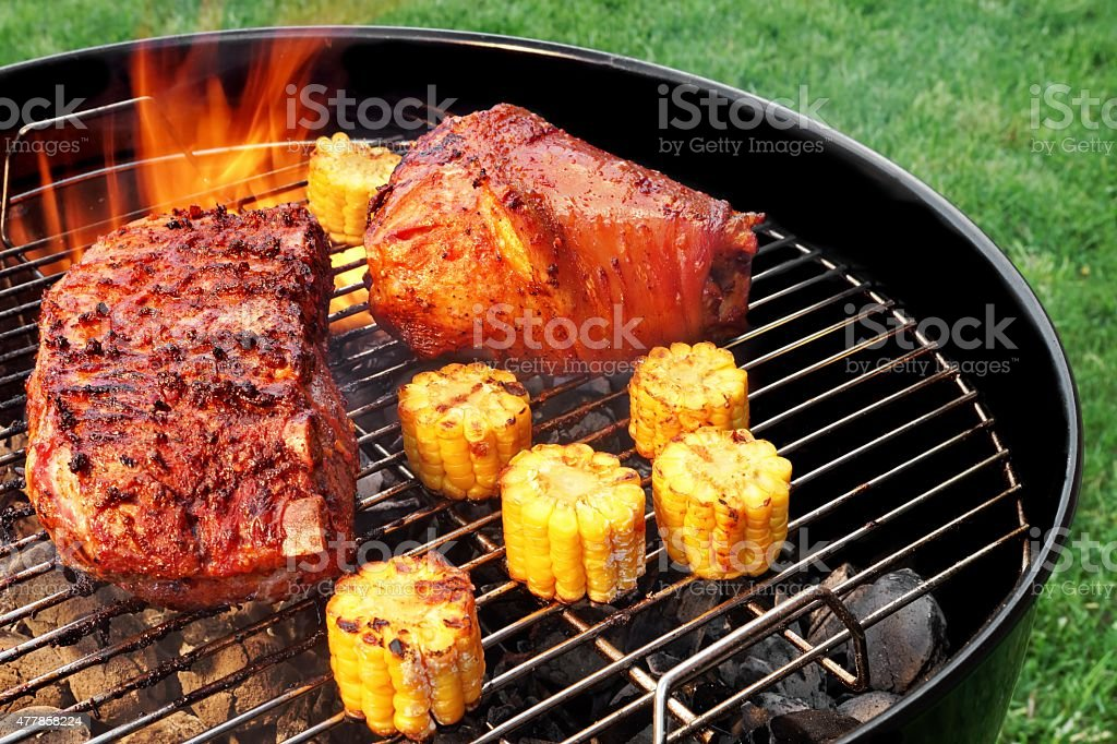 BBQ Grill With Pork Eisbein Brisket And Corn Rings stock photo