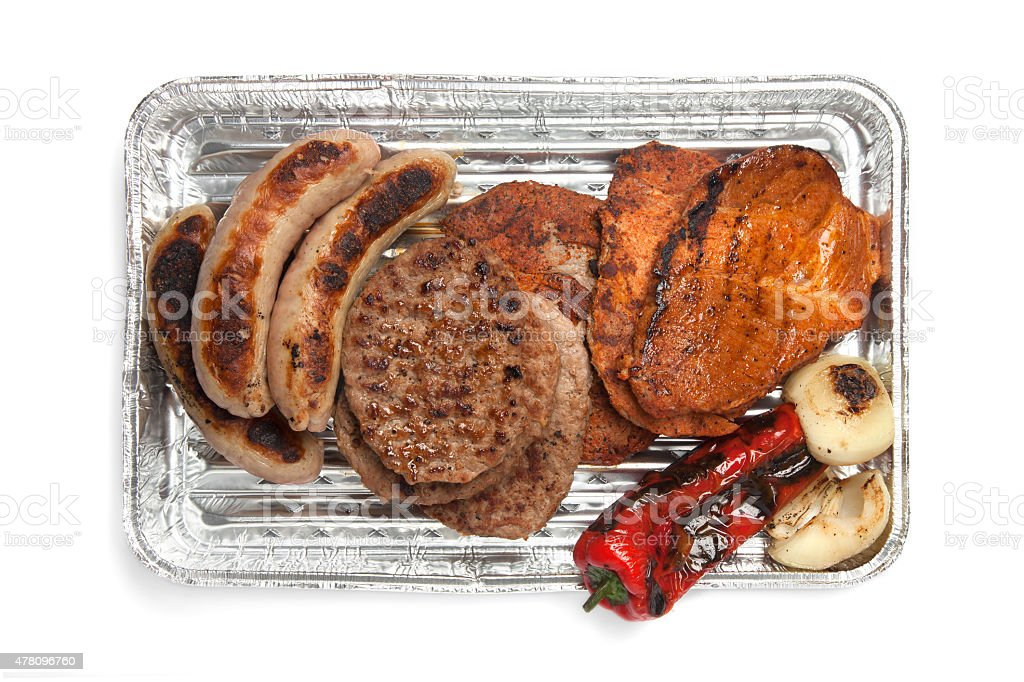 Grillables, grilled meat and sausages on barbecue tray stock photo