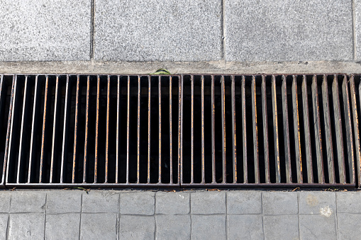 Grille drain of sewer around the street or walkway. Water recirculation system. Wastewater treatment.