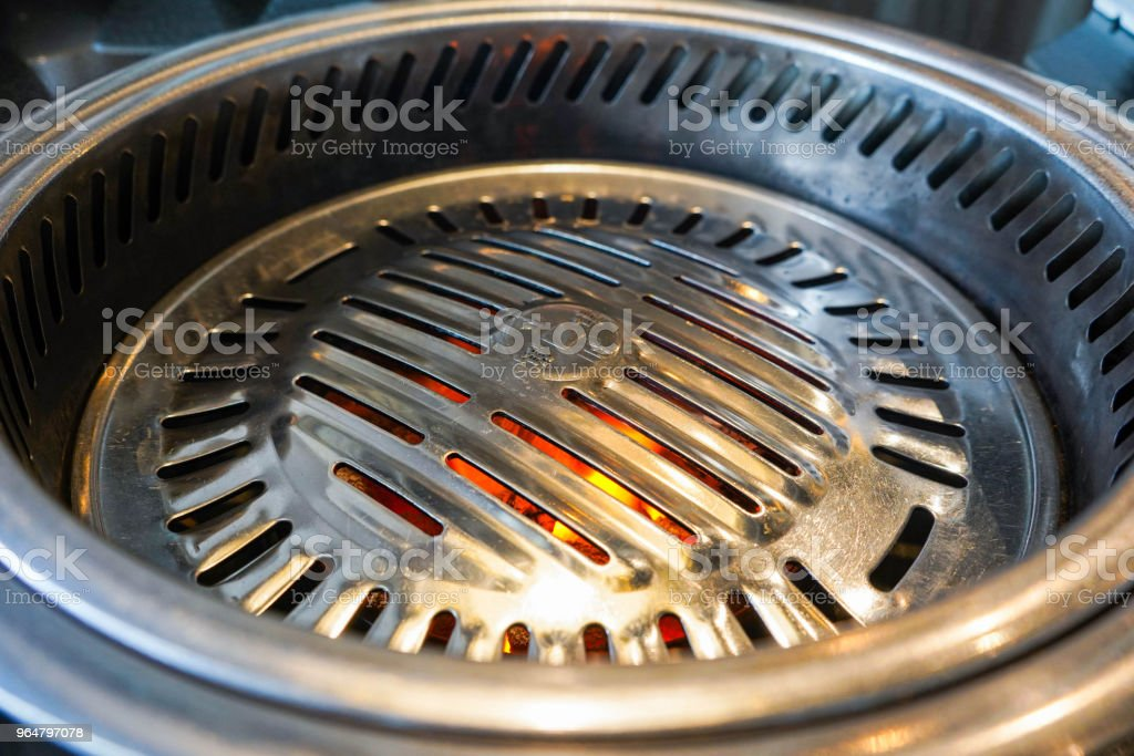grille with fire for korean barbeque royalty-free stock photo